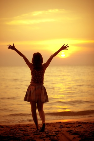 Silhouette of a girl in the beach photo
