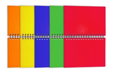 Colorful spiral notebooks isolated on white background photo
