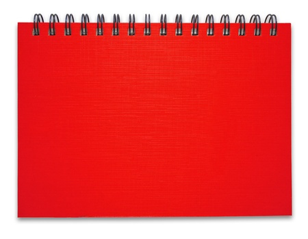 Red notebook on the white background photo
