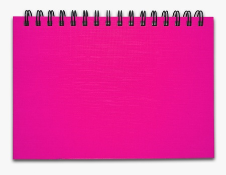 Pink notebook on the white background photo