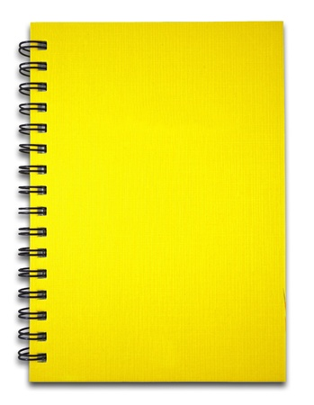 Yellow notebook on the white background photo