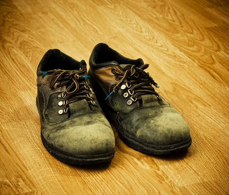 pair of old used trekking boots on the wood background Stock Photo - 9659365