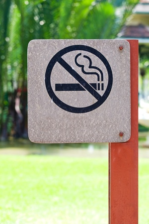 no smoking metal sign in the park photo