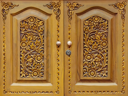 Wooden carved doors closeup photo