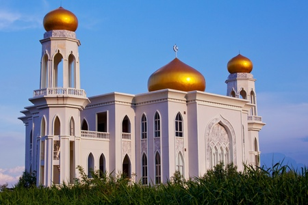 the blue domes: View of islamic mosque on sunset