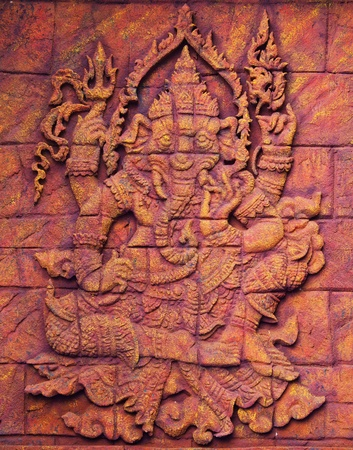 Stone carved sculpture of elephant god Ganesha photo