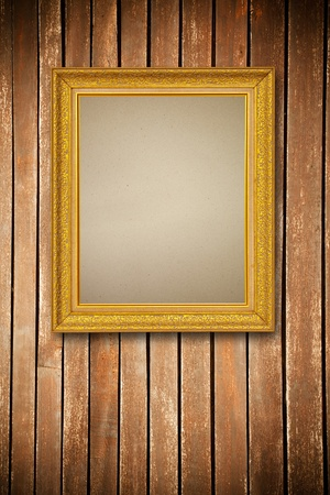 Gold frame on wood wall background photo