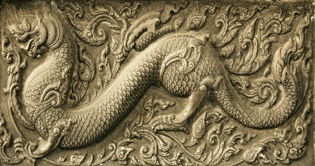 Dragon Chinese carved on stone wal photo