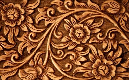 Muster der Blume auf Holz Hintergrund geschnitzt