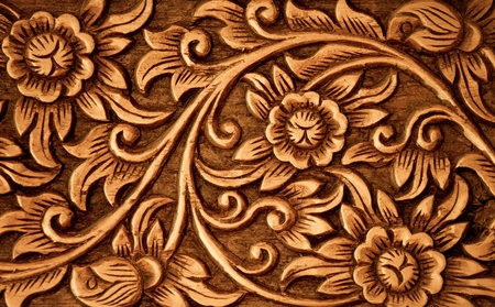 wood carving: Pattern of flower carved on wood background
