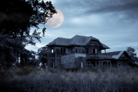Haunted halloween house with full moon photo