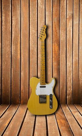 Electric guitar on wood wall photo