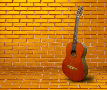 Spanish guitar on old wall photo