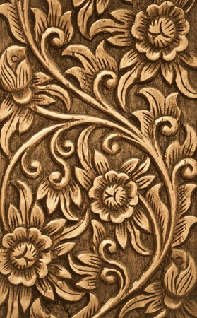Pattern of flower carved on wood background Stock Photo - 10763123