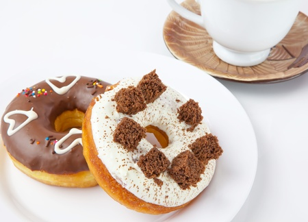 donuts and coffee on white background Stock Photo - 10846947