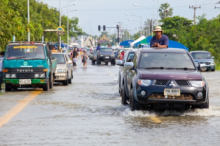 AYUTTHAYA - OCTOBER 9,2011: Pickup truck transporting flood victims through the streets of the city during the worst monsoon flood. October 9, 2011 in Ayutthaya, Thailand.