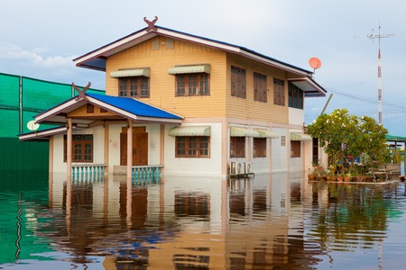 waters: flood waters overtake house in Thailand Editorial