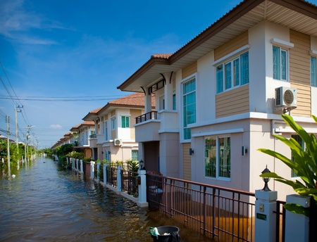 overtake: flood waters overtake house in Thailand Editorial