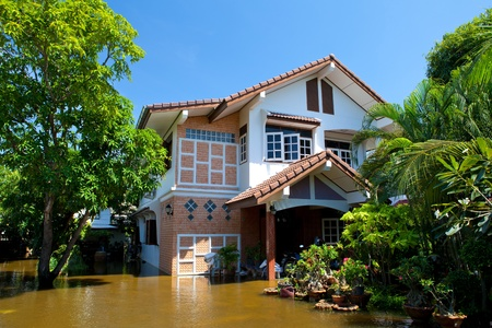 thailand flood: flood waters overtake house in Thailand Editorial