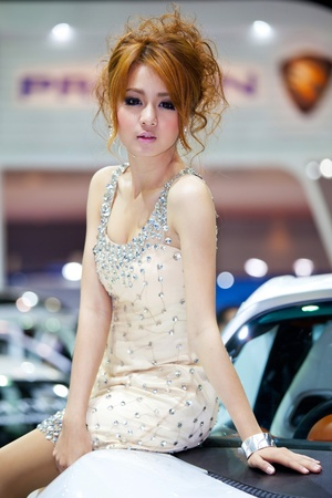 BANGKOK, THAILAND - MARCH 26, 2011: Unidentified female presenter at Proton booth in the 32nd Bangkok International Motor Show on March 26, 2011 in Nonthaburi, Thailand.