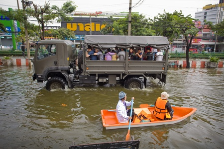 BANGKOK, THAILAND - NOVEMBER 5, 2011: People uses boat as a transportation through water during the worst flooding in decades on November 5,2011 Bangkok, Thailand. Stock Photo - 11109385