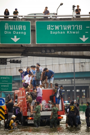 worst: BANGKOK, THAILAND - NOVEMBER 5 : Rescue teams helping people to get home during the worst flooding in decades on November 5,2011 Bangkok, Thailand.