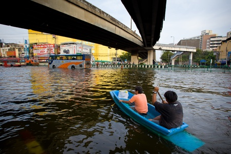 BANGKOK, THAILAND - NOVEMBER 5, 2011: People uses boat as a transportation through water during the worst flooding in decades on November 5,2011 Bangkok, Thailand.
