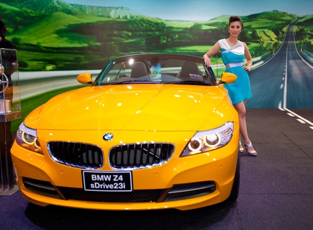 BANGKOK, THAILAND - MARCH 26, 2011: Unidentified female presenter at BMW booth in the 32nd Bangkok International Motor Show on March 26, 2011 in Nonthaburi, Thailand.