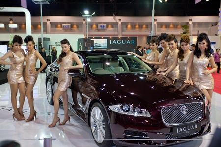 BANGKOK, THAILAND - MARCH 26, 2011: Unidentified females presenter at Jaguar booth in the 32nd Bangkok International Motor Show on March 26, 2011 in Nonthaburi, Thailand.