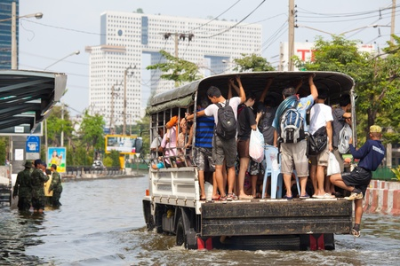 BANGKOK, THAILAND - NOVEMBER 5, 2011 : Rescue teams helping people to get home during the worst flooding in decades on November 5,2011 Bangkok, Thailand. Stock Photo - 11116801