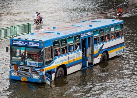 inundated: BANGKOK, THAILAND - NOVEMBER 5, 2011 : Thai flood hits Central of Thailand, higher water levels expected, cars navigating through the flood on November 5,2011 Bangkok, Thailand. Editorial
