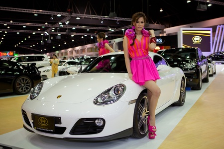 BANGKOK, THAILAND - DECEMBER 3,2011: Unidentified females presenter at TSL booth in the 28th Thailand International Motor Expo 2011 on December 3, 2011 in Nonthaburi, Thailand. Stock Photo - 11379318