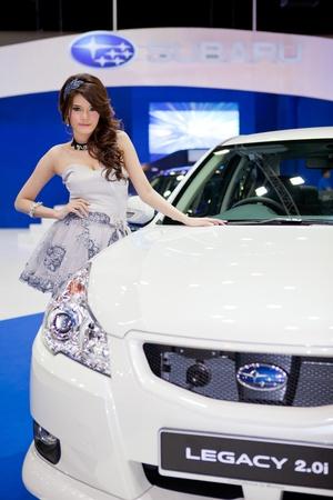 subaru: BANGKOK, THAILAND - DECEMBER 3,2011: Unidentified female presenter at Subaru booth in the 28th Thailand International Motor Expo 2011 on December 3, 2011 in Nonthaburi, Thailand.