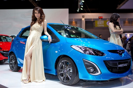 BANGKOK, THAILAND - DECEMBER 3,2011: Unidentified females presenter at Mazda booth in the 28th Thailand International Motor Expo 2011 on December 3, 2011 in Nonthaburi, Thailand. Stock Photo - 11379312