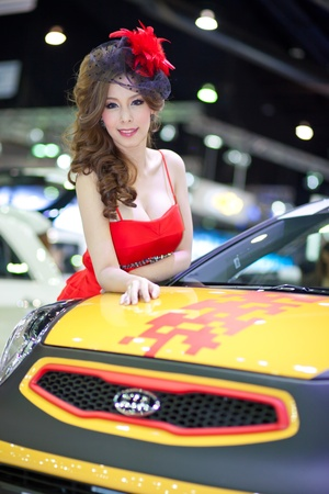 BANGKOK, THAILAND - DECEMBER 3,2011: Unidentified females presenter at KIA booth in the 28th Thailand International Motor Expo 2011 on December 3, 2011 in Nonthaburi, Thailand.