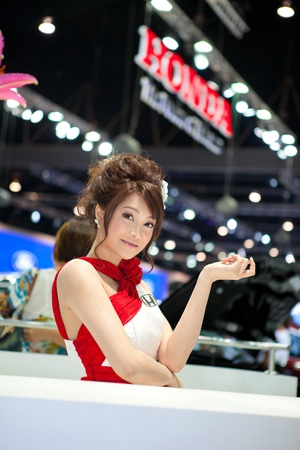BANGKOK, THAILAND - DECEMBER 3,2011: Unidentified female presenter at Honda booth in the 28th Thailand International Motor Expo 2011 on December 3, 2011 in Nonthaburi, Thailand. Stock Photo - 11400564