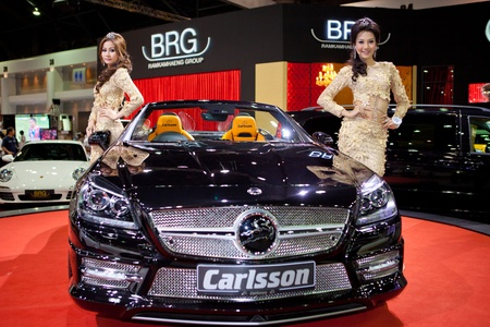 BANGKOK, THAILAND - DECEMBER 3,2011: Unidentified females presenter at BRG booth in the 28th Thailand International Motor Expo 2011 on December 3, 2011 in Nonthaburi, Thailand.