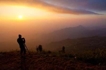 silhouette of photographers on the Mountain