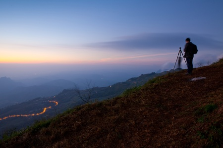silhouette of photographers on the Mountain photo
