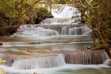 Autumn forest Waterfall in Thailand photo