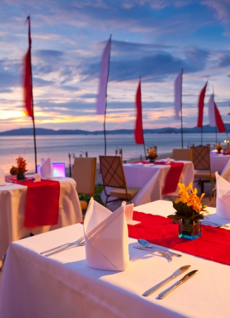 dinner on sunset at beach in Thailand photo