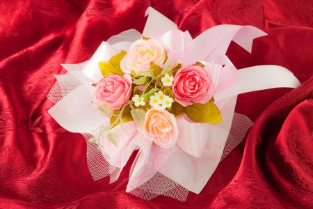 Valentine's day roses on red fabric photo