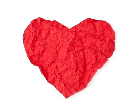 Red crumpled paper heart isolated on white background photo