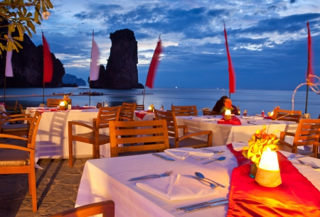 dinner on sunset at beach in Thailand Stock Photo - 12073876