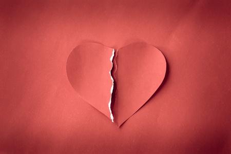 heartbroken: Red grunge heartbroken on red background