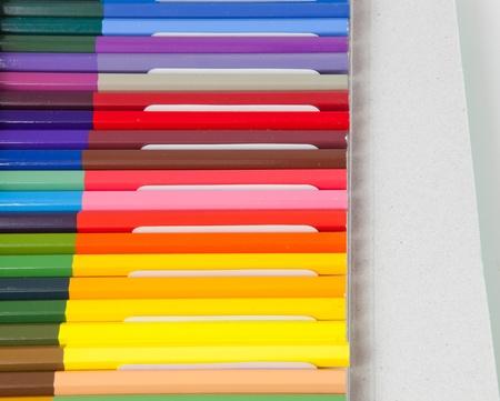 pencil box: Color pencils in a box on white