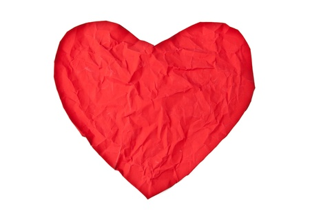 crumpled paper heart isolated on white background photo