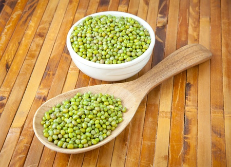 mung beans over wooden spoon on wood background photo