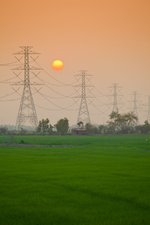 isolator high voltage: Electric power station in the field on sunset
