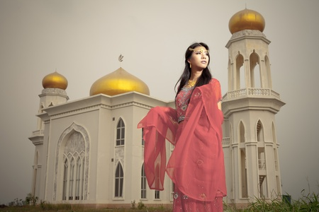 islamic prayer: Muslim woman in front of the Mosque